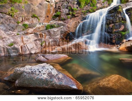 Deep forest waterfall at Geres National Park, north of Portugal
