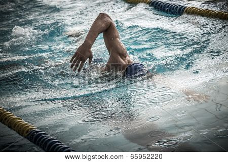 Swimmer in a swimming pool using crawl technique