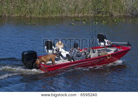 Couple And Dog On A Fishing Outing