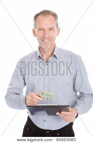 Looking At Clipboard Through Magnifying Glass