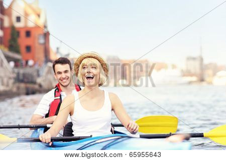 A picture of a young couple in a canoe