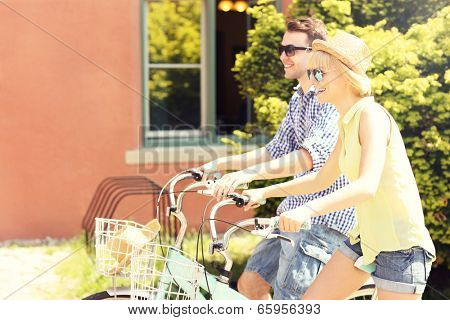 A picture of a happy couple spending free time on bikes