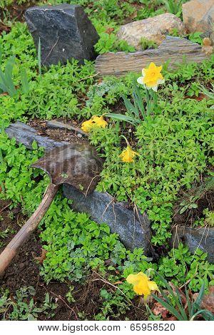 Gardening shovel in dirt