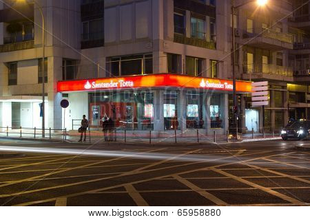 LISBON, PORTUGAL - MAY 28, 2014: Banco Santander Totta at night in Lisbon. Banco Santander Totta  is a Portuguese bank. It is the fourth largest bank in Portugal and the third largest private bank.