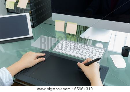 Business woman  graphic designer working in office using tablet pen