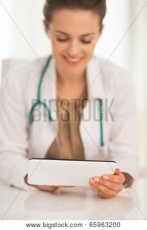 Closeup On Happy Medical Doctor Woman Using Tablet Pc