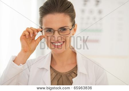 Portrait Of Smiling Ophthalmologist Doctor Woman Wearing Eyeglas