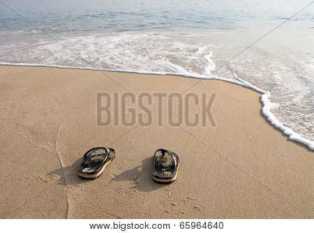 Beach Slippers  In The Sand On Beach