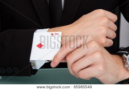 Businessman With Cards In Sleeve
