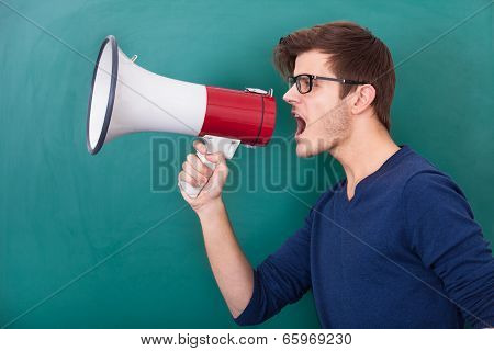 Young Man Shouting In Megaphone