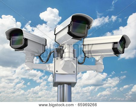 CCTV security camera on cloud sky background. 3d