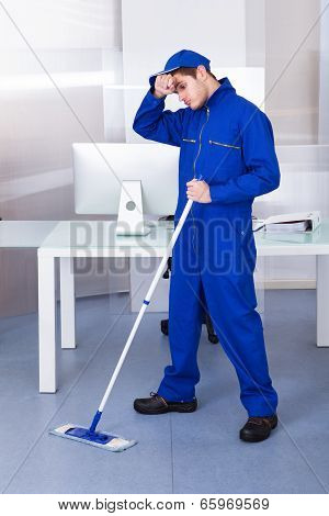 Tired Man Cleaning Floor