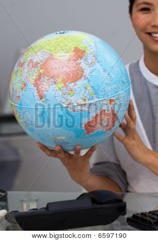 Close-up Of An Asian Businesswoman Holding Terrestrial Globe