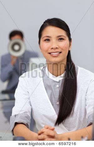 Businessman Shouting Through A Megaphone