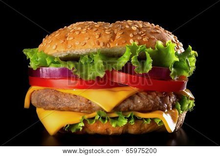 Classic Burger buns with sesame seeds, beef patty, tomato, onion and lettuce.