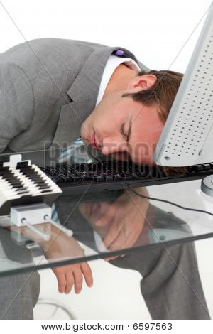 Tired Businessman Sleeping On His Desk