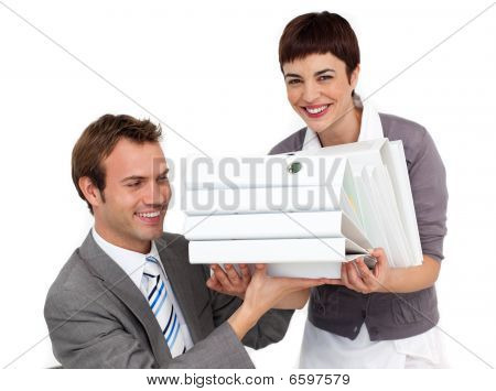 Smiling Businesswoman Bringing A Stack Of Folders To Her Manager