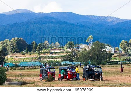 Row Of Tuk-tuks On The Field