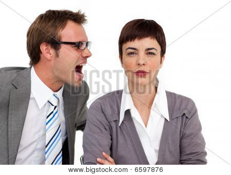 Angry Businessman Shouting Into His Colleague's Ear