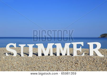 Seascape with white word summer on the sand
