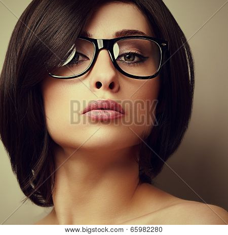 Beautiful Makeup Fashion Girl In Modern Glasses Looking. Closeup Portrait