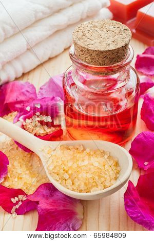 Oil In Glass Bottle, Sea Salt, Towel And Rose Petals