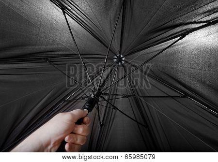 Hand Opens Big Black Umbrella