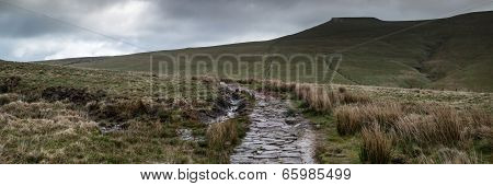 Panorama Landscape Of Path Leading Towards Corn Du Mountain In Brecon Beacons