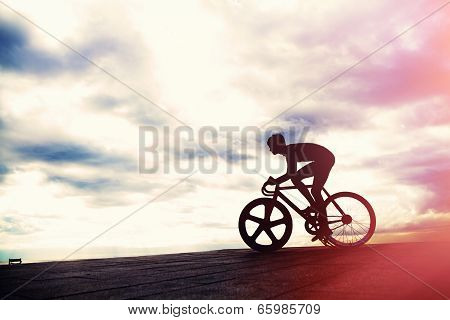 Silhouette of a sporstgirl on a racing track bike