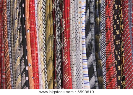 Multicolor ties on a rack