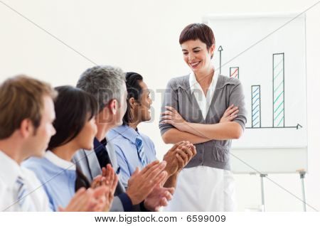 A Diverse Business Group Applauding A Good Presentation