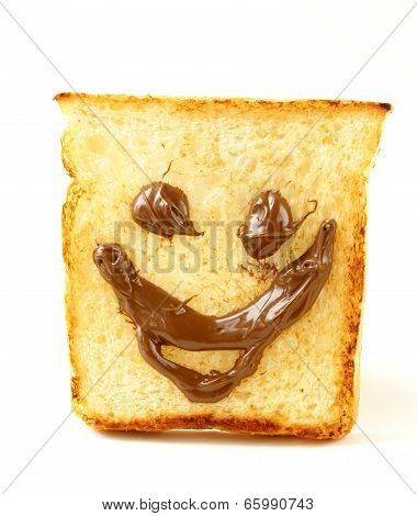 funny toast bread with chocolate smile on white background