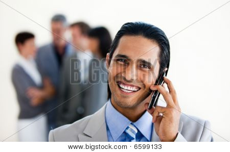 Focus On An Assertive Ethnic Businessman On Phone