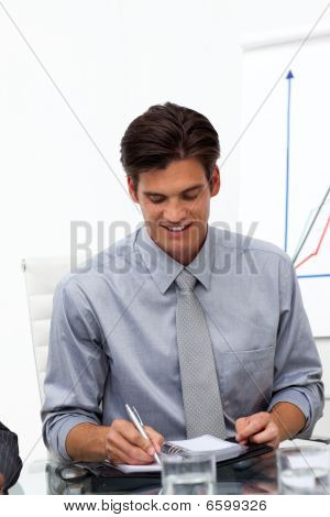 Businessman Consulting His Agenda In A Meeting