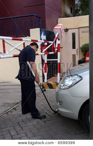 security checking car at gate