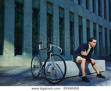 Stylish young man with classic bicycle Stylish young man with classic bicycle