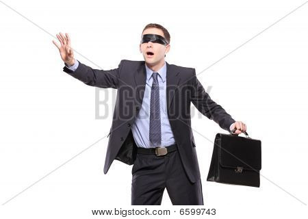 Confused Blindfold Businessman With Briefcase