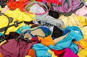 stock photo of untidiness  - Untidy cluttered wardrobe with colorful clothes and accessories - JPG