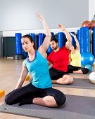 pic of oblique  - Pilates exercise the mermaid stretching obliques people group at fitness gym - JPG