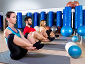 picture of pilates  - Pilates people group the seal exercise man and women at fitness gym - JPG