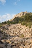 picture of ravines  - A dry ravine bed full of huge boulders - JPG