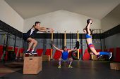 foto of barbell  - gym people group workout barbells slam balls and jump exercises - JPG