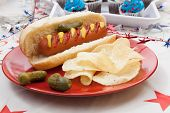 stock photo of baking soda  - Hot dog chips and pickled cucumbers - JPG