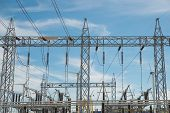 picture of substation  - High voltage power transformer in substation with power wind mill - JPG
