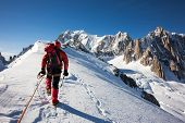 picture of diligent  - Mountaneer climbs a snowy ridge in Mont Blanc - JPG