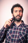 foto of moustache  - young man with strage expression when cut his beard and moustaches - JPG
