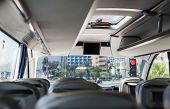 image of emergency light  - Photograph of interior of empty coach bus from the behind of seats - JPG