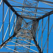 image of transmission lines  - a long line of electrical transmission towers carrying high voltage lines - JPG