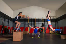 picture of slam  - gym people group workout barbells slam balls and jump exercises - JPG