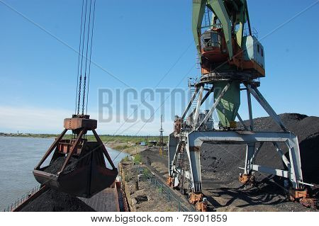 Crane Loading Coal To Ship At Kolyma River Port